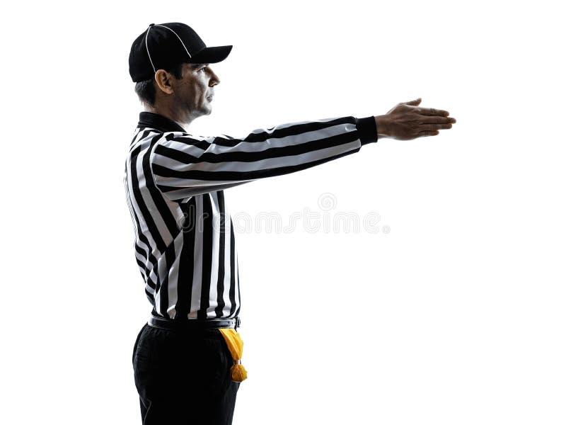 橄榄球裁判员打手势第一下来现出轮廓 免版税库存图片