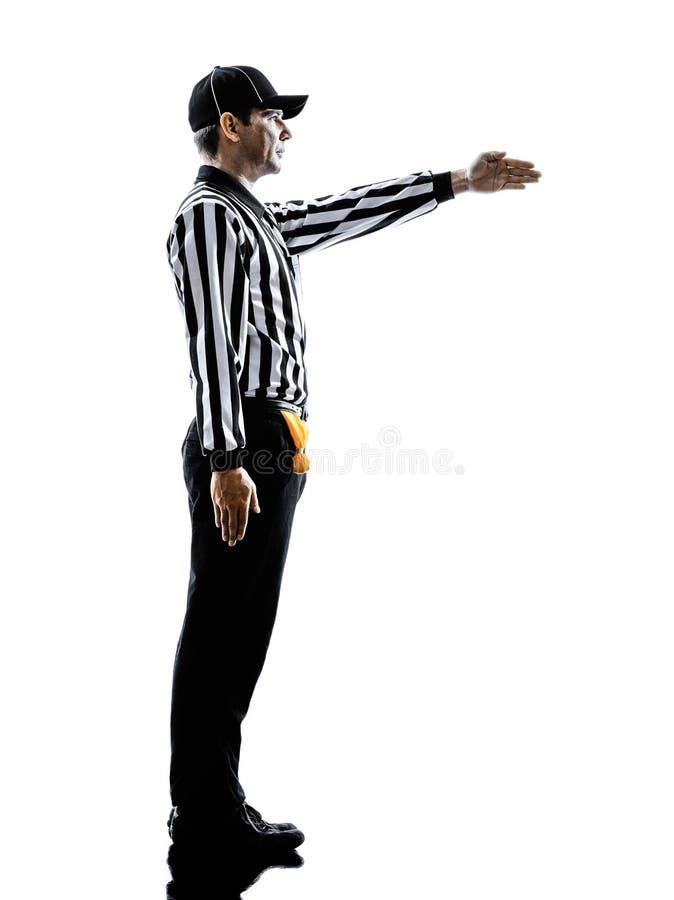 橄榄球裁判员打手势第一下来现出轮廓 图库摄影