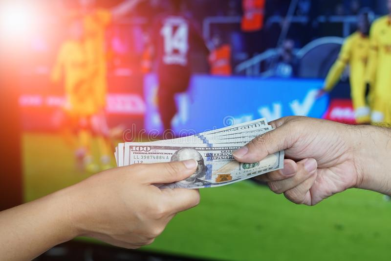 橄榄球赌博的概念 图库摄影