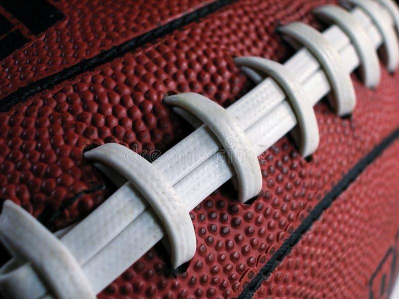橄榄球鞋带倾斜了 库存图片