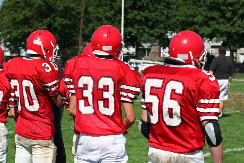 橄榄球高中小组 免版税库存图片