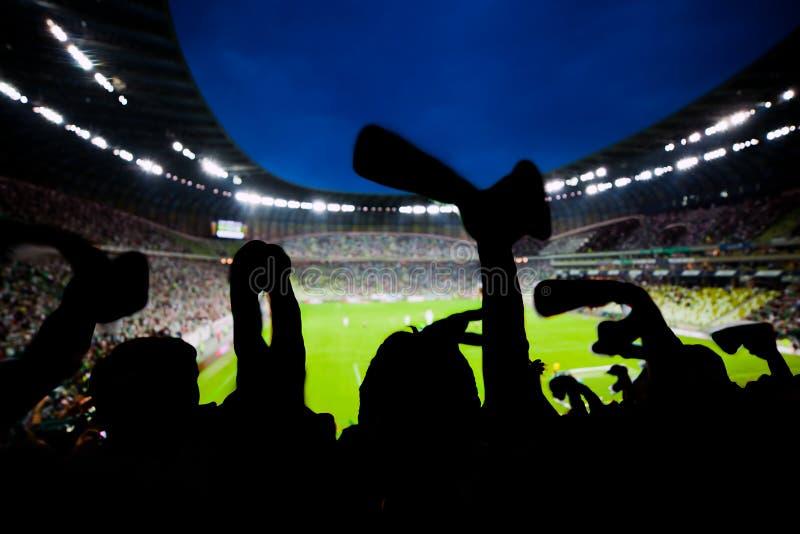 橄榄球,足球迷支持他们的队并且庆祝 库存照片