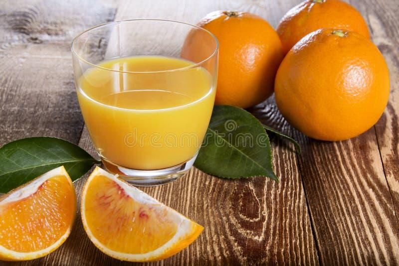 橙汁玻璃 免版税图库摄影