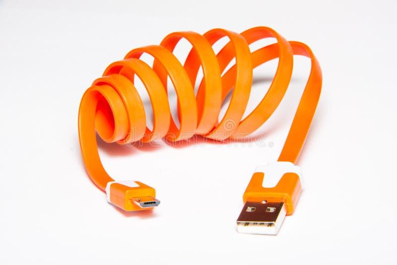 橙色卷起的USB缆绳 库存照片