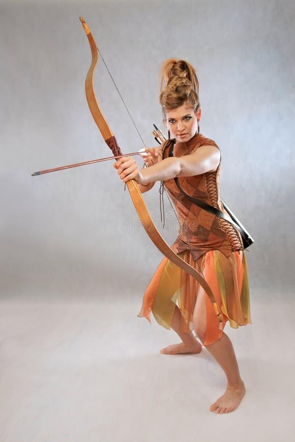 橙色和棕色成套装备的,战士,时尚妇女 免版税库存图片
