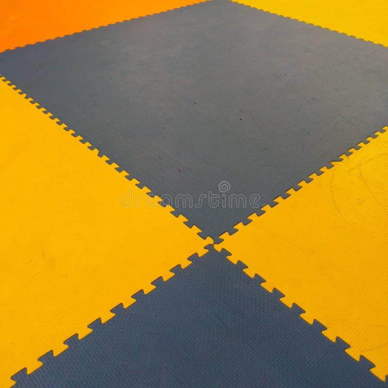 橙色地毯难题,块 免版税库存图片