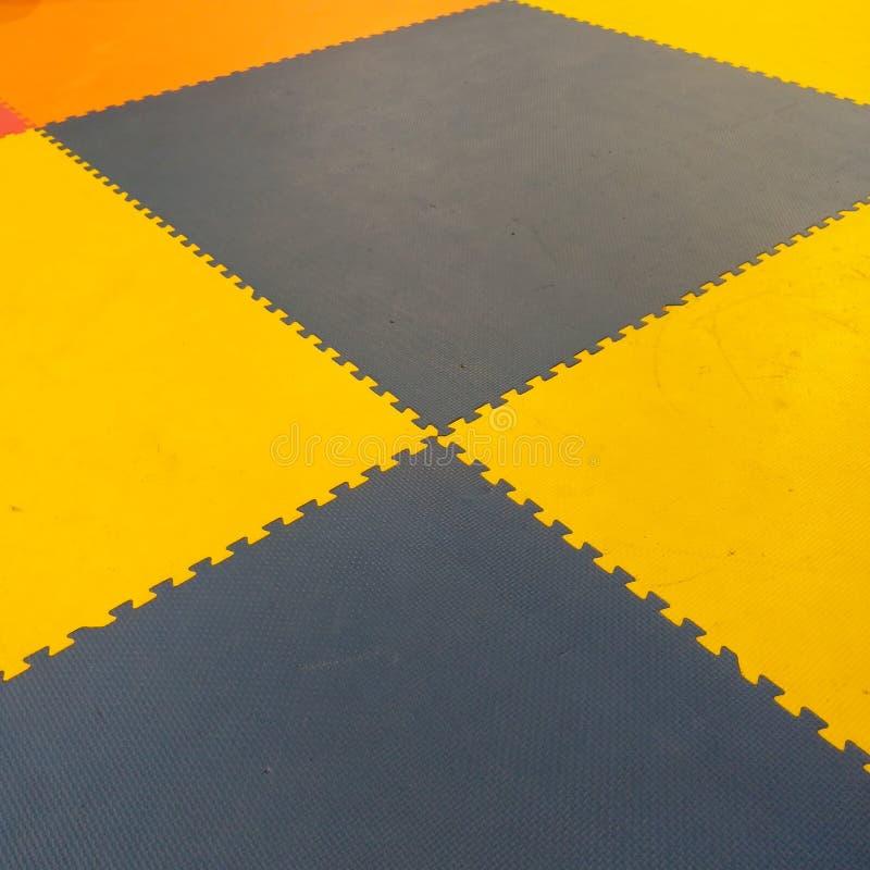 橙色地毯难题 库存照片