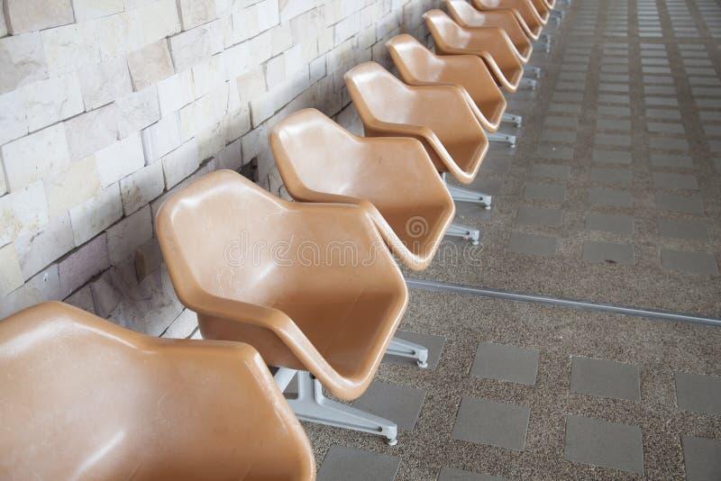 橙色塑料椅子 免版税库存图片