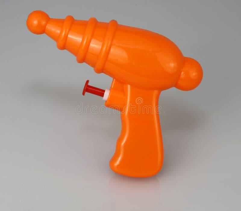 橙色塑料玩具放射枪 库存图片