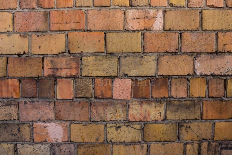 橙色墙壁由砖做成 库存照片