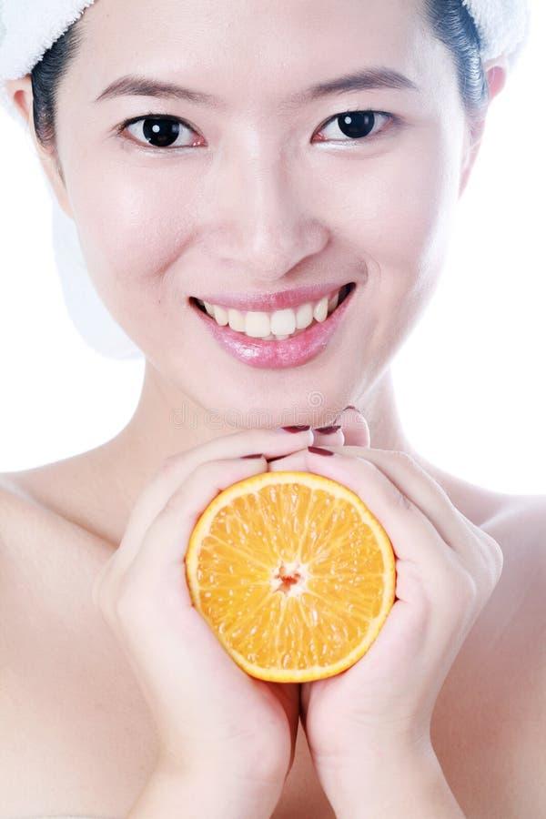 橙色妇女年轻人 免版税库存图片