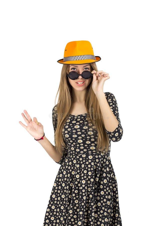 橙色帽子的时髦的夫人 库存图片