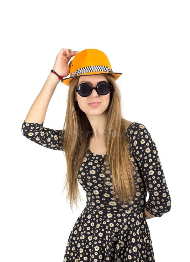 橙色帽子的时髦的夫人 免版税图库摄影