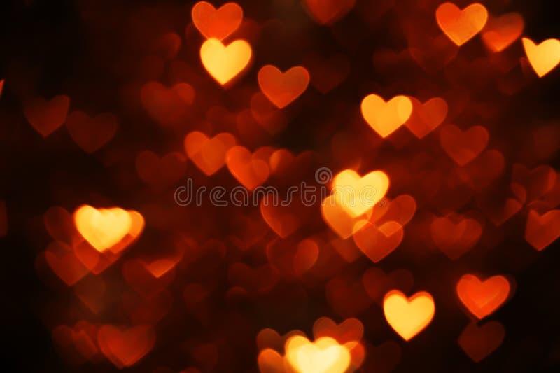 橙色心脏bokeh 图库摄影