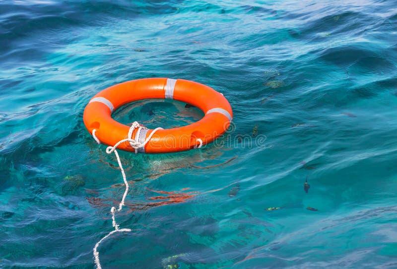 橙色救生圈安全设备 免版税库存图片