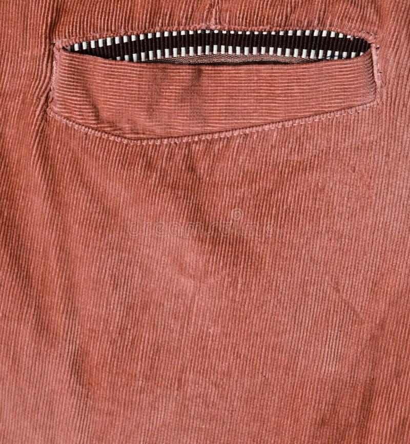橙色条绒裤子纹理  后方口袋 库存照片