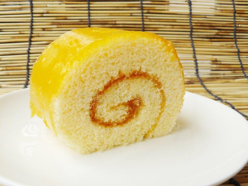 橙色果酱卷蛋糕 库存照片