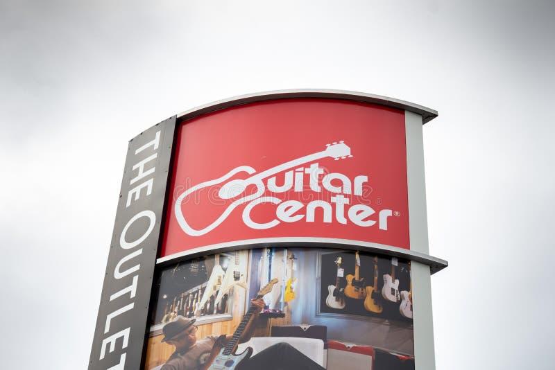 橙色标志出口的好莱坞吉他中心  免版税库存图片