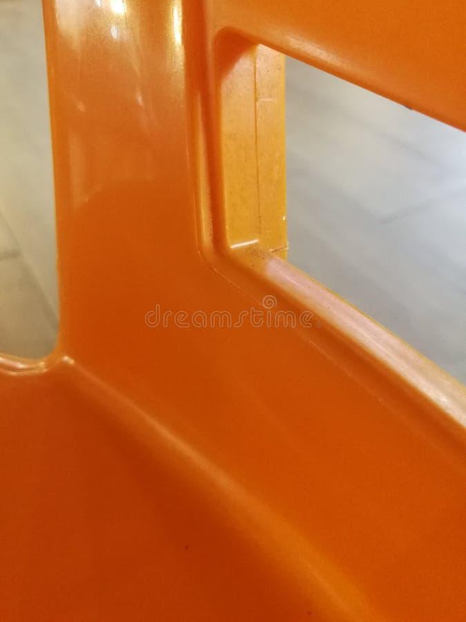 橙色椅子的阴影 免版税图库摄影