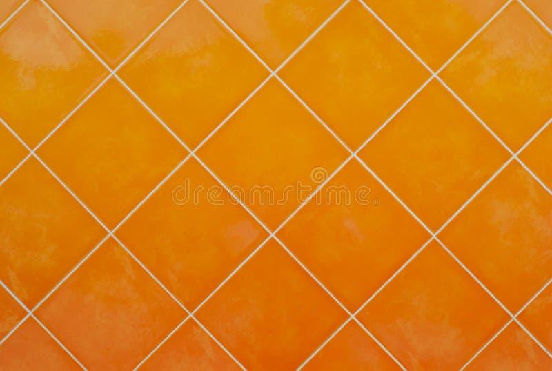 橙色瓦片光滑的马赛克陶器材料背景 免版税库存图片