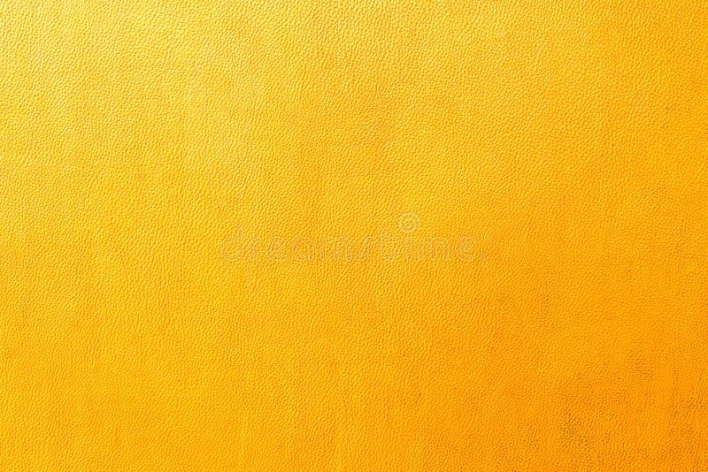 橙色皮革背景  免版税图库摄影