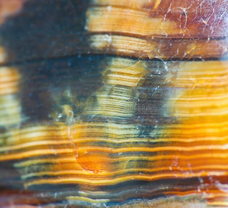 橙色石纹理宏观照片与线的 免版税库存照片