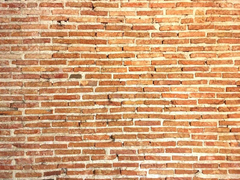 橙色砖墙有具体背景 免版税库存图片