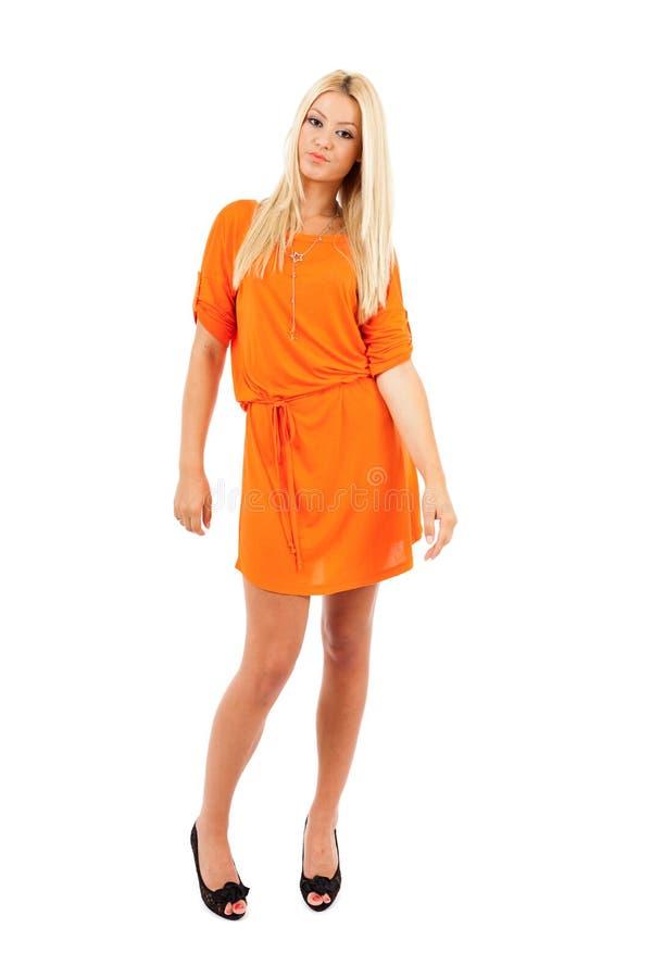橙色礼服的妇女 免版税库存照片