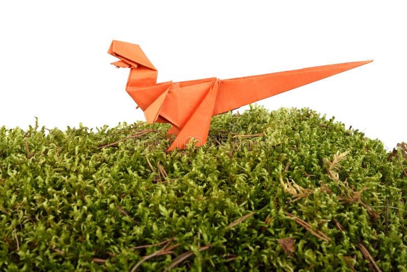 橙色纸恐龙 库存照片