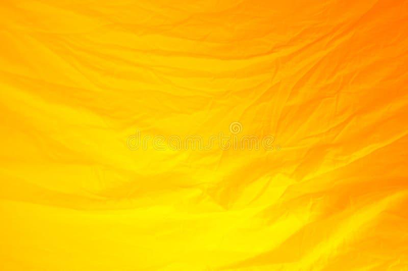橙色织品纹理背景,被弄皱的织品背景 库存图片