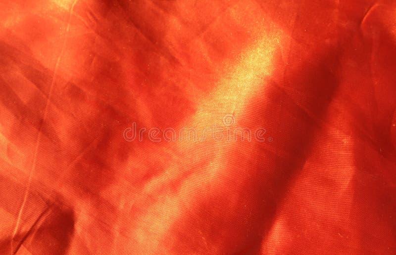 橙色织品背景 库存照片