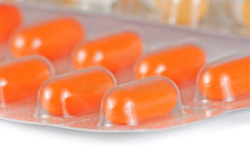 橙色药片细节在被隔绝的水泡包装了 库存照片
