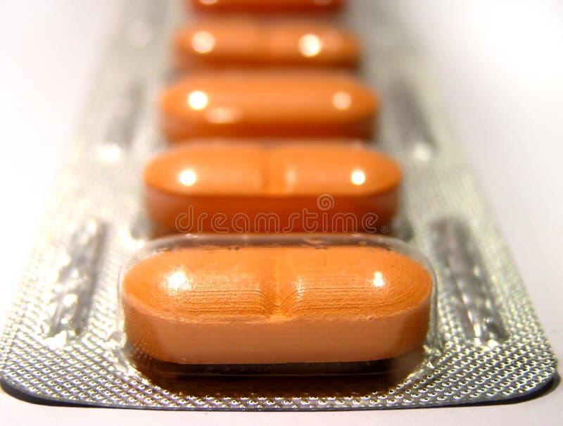 橙色药片 免版税库存图片
