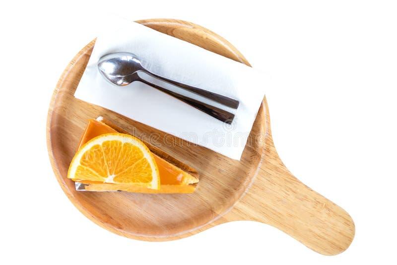 橙色蛋糕片断在木板的 免版税库存照片