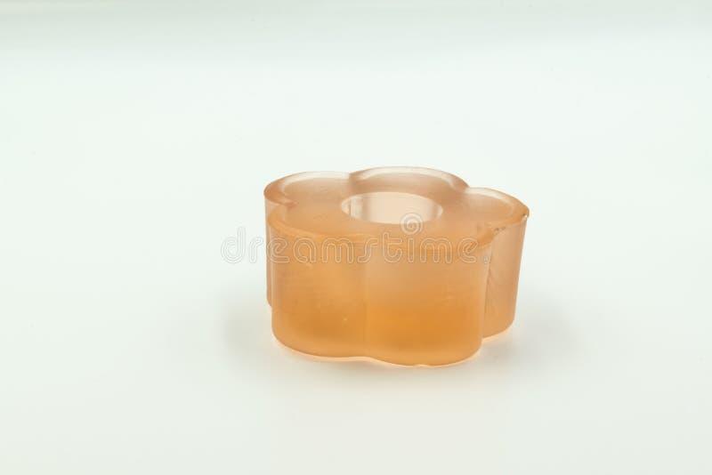 橙色蜡烛台由玻璃制成 免版税库存照片
