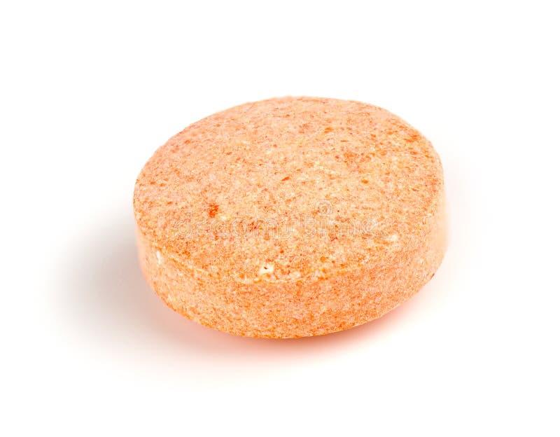 橙色被隔绝的维生素C耐咀嚼的片剂宏观特写镜头  库存图片