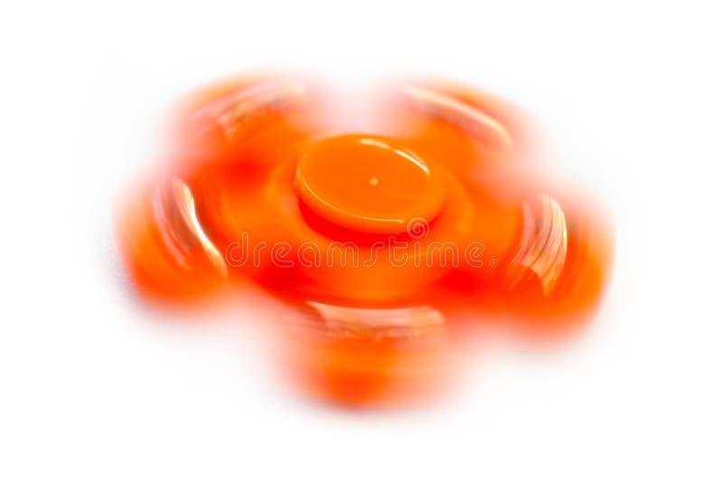 橙色转动的坐立不安锭床工人低速快门  库存照片