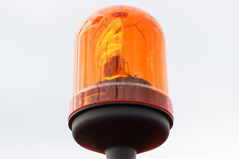 橙色转动的烽火台或警报器光当安全标志 库存图片