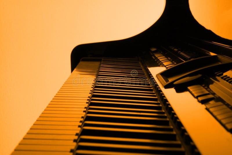 橙色钢琴 库存照片
