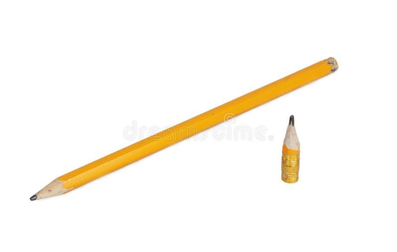 橙色长和短的铅笔 免版税图库摄影
