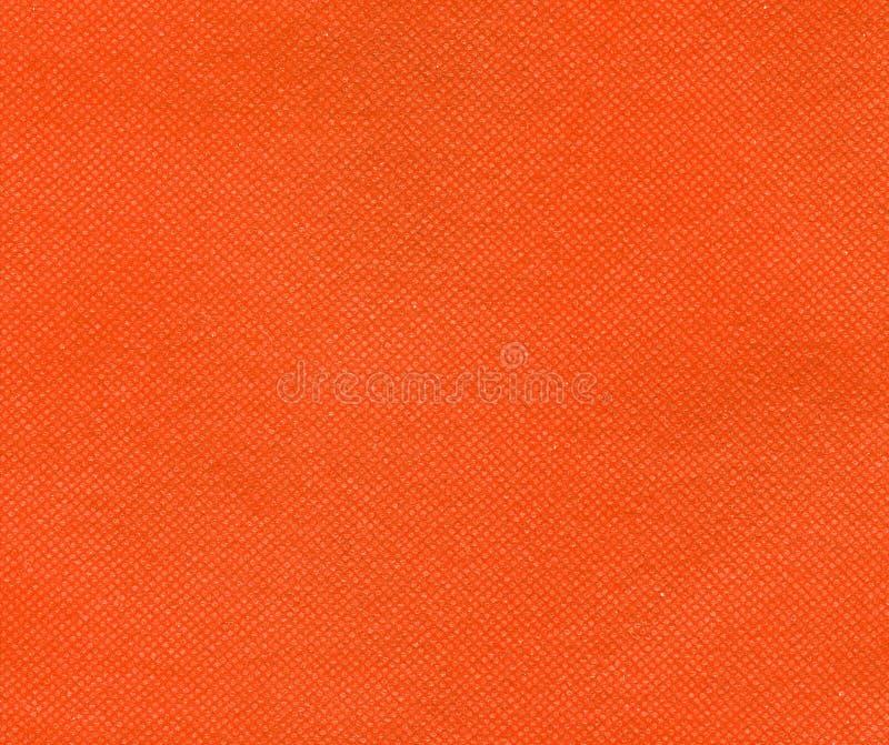 橙色非编织的聚丙烯织品纹理背景 免版税库存图片