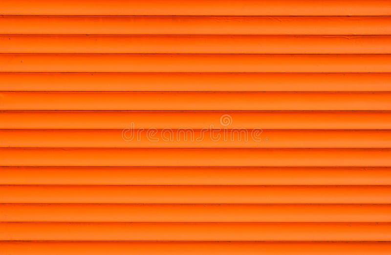 橙色水平的路辗快门窗帘 免版税库存图片
