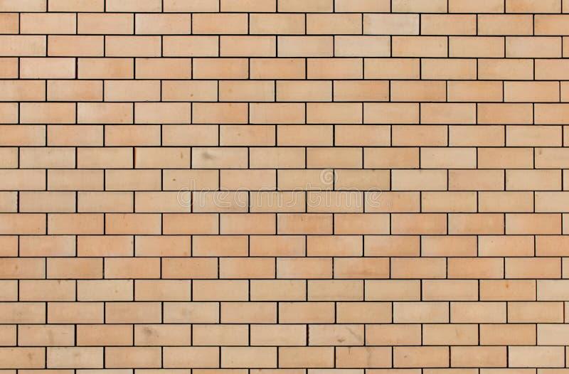 橙黄砖墙背景,被构造,样式 库存图片