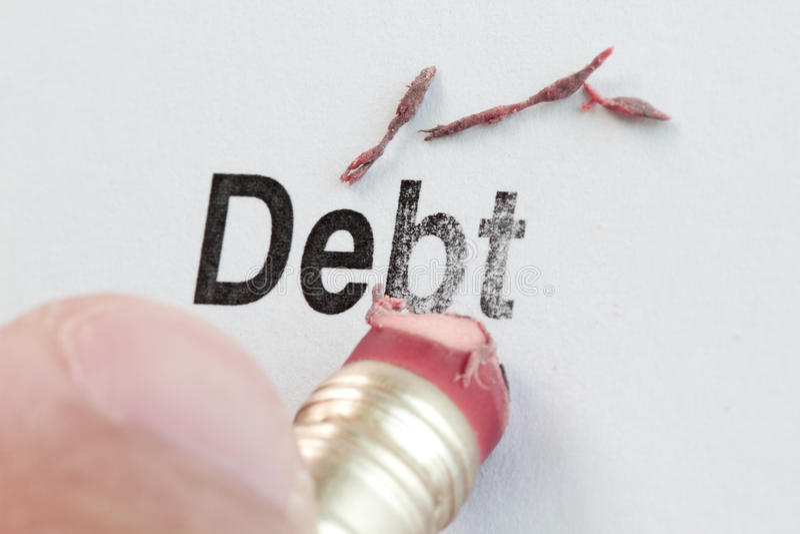 橡皮擦和字负债 免版税库存照片