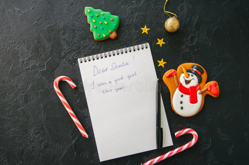 欢乐圣诞节背景,笔记薄白页与inscrip的 库存照片