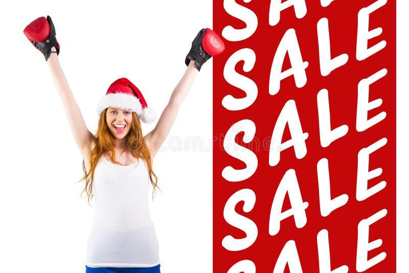 欢呼与拳击手套的欢乐红头发人的综合图象 免版税库存照片