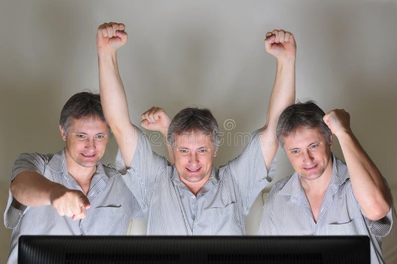 欢呼的三胞胎 图库摄影