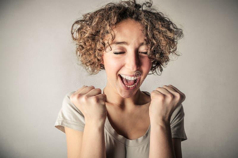 欢呼的愉快的妇女 免版税图库摄影