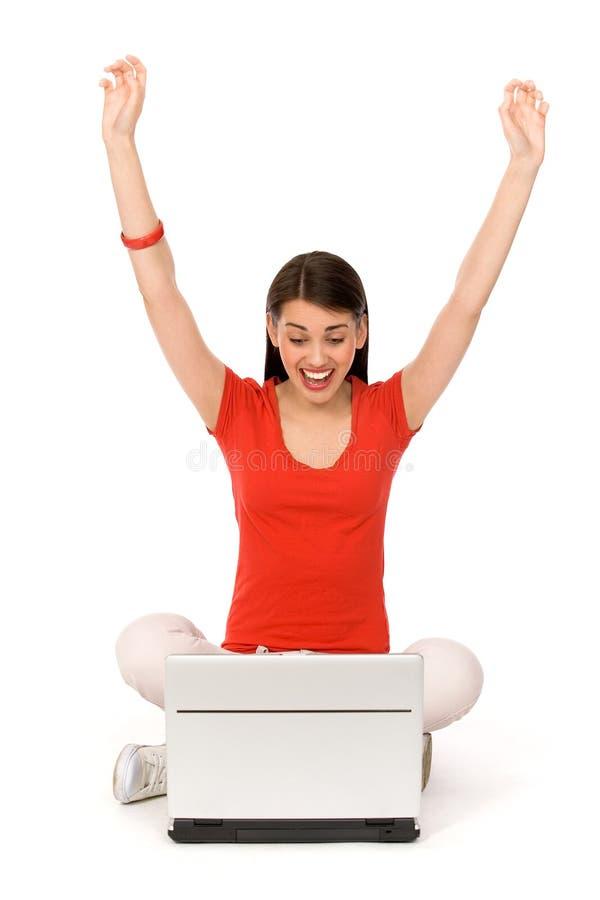 欢呼的膝上型计算机妇女 库存照片