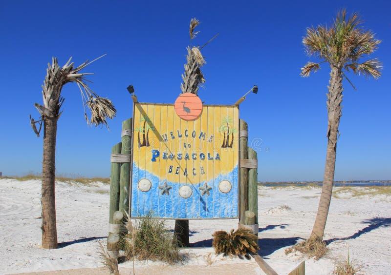 欢迎到彭萨科拉海滩 库存图片